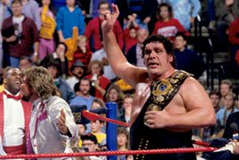 Andre The Giant hands the WWE Title over to The Million Dollar Man.