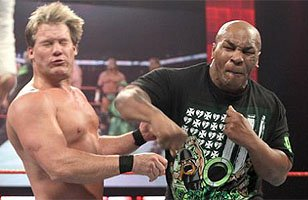 """Iron Mike"" lets loose on Chris Jericho with a right hook."
