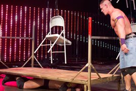 John Cena prepares to dump dozens of chairs on top of Wade Barrett