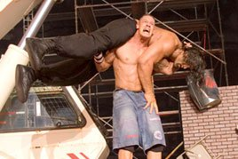 John Cena prepares to deliver a monster-sized Attitude Adjustment to The Great Khali