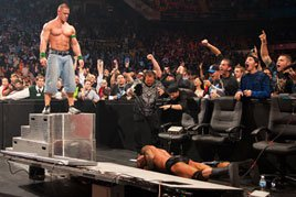 John Cena sends Randy Orton crashing through a table