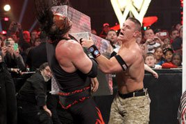 John Cena goes after Kane with the steel ring steps
