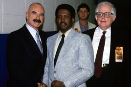G. Gordon Liddy (left) is ready for WrestleMania 2.