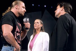 Stephanie McMahon and Eric Bischoff try to convince Triple H to join their brand