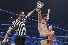 The referee raises the arm of Cody Rhodes, the new Intercontinental Champion.