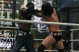 R-Truth and CM Punk grapple in the 2010 Elimination Chamber Match.