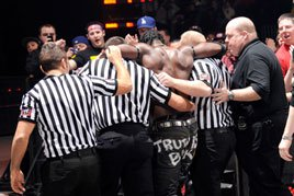 R-Truth is helped to the locker room by WWE officials on Raw SuperShow.
