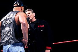 "Facing ""Stone Cold"" Steve Austin, Mr. McMahon sports an edgy Raw jacket."