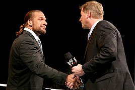 WWE COO Triple H shakes the hand of Interim Raw GM John Laurinaitis.