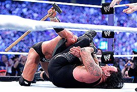 After a grueling bout, The Undertaker put away Triple H.