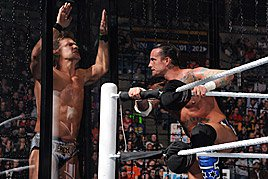 CM Punk taunts Chris Jericho from the other side of the pod glass