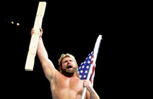 """Hacksaw"" Jim Duggan totes his trademark 2x4."