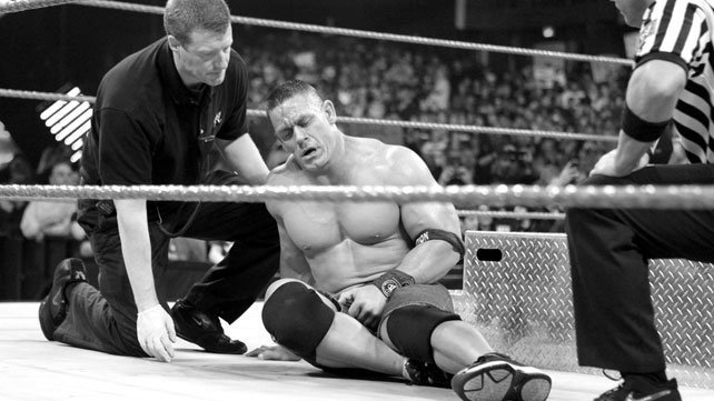 John Cena is tended to by medical technicians after his Extreme Rules Match with Brock Lesnar