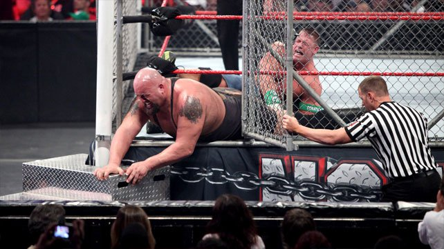 John Cena pulls Big Show back into the steel cage by his leg during their match at WWE's No Way Out 2012.