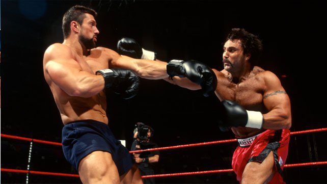 Steve Blackman and Marc Mero trade fists during Brawl for All.