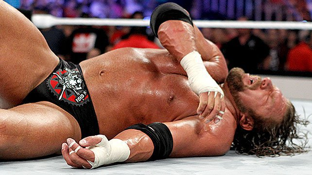 Triple H's arm broken at SummerSlam