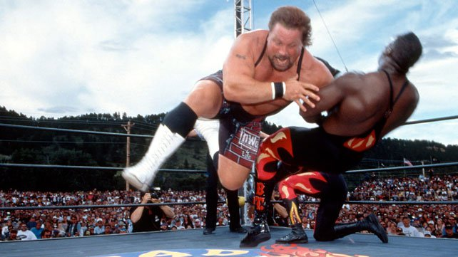 Scott Norton tackles Booker T